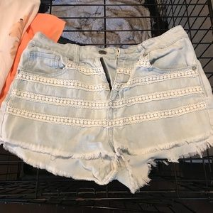 Light wash high waisted shorts with lace trim